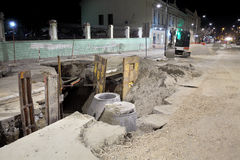 Construction site, sewerage in city. Hydro construction work, reconstruction of sewerage, night photo Royalty Free Stock Photography