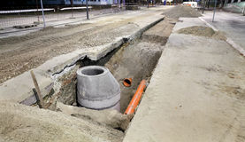 Construction site, sewerage in city. Hydro construction work, reconstruction of sewerage, night photo Stock Photo
