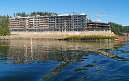 Construction Site on the Shore of a Mountain Lake Stock Photo