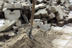 Construction site. With shovel and precast concretes Royalty Free Stock Photos