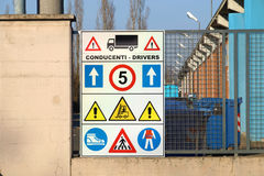 Construction site sign with safety notices hanging on wall Stock Images