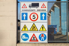 Construction site sign with safety notices hanging on wall Royalty Free Stock Photos