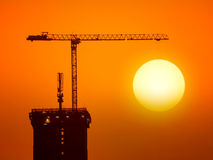 Construction site with silhouette crane Royalty Free Stock Photos