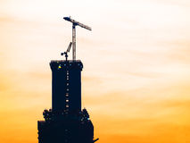 Construction site with silhouette crane Royalty Free Stock Image