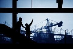 Construction site silhouette. With crane and workers Royalty Free Stock Image