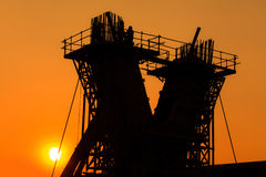 Construction site. Silhouette of Construction site at sun set Royalty Free Stock Image
