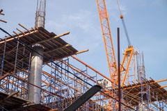 Construction site with steel and concrete pillars are molded into the structure of the building. S Stock Photo