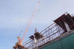 Construction site with steel and concrete pillars are molded into the structure of the building. S Stock Photos