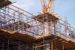 Construction site with steel and concrete pillars are molded into the structure of the building. S Royalty Free Stock Photo