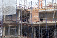 Construction site with steel and concrete pillars are molded into the structure of the building. S Royalty Free Stock Images