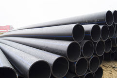 Construction site. Storage vodoprovodnyh large diameter pipes made ​​of polyethylene. Water pipes made ​​of black polyethylene royalty free stock images