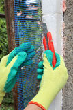 Construction site, styrofoam insulation mesh cutting Stock Photos