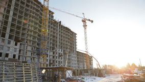 Construction site on sunset background. Landscape construction of a multi-storey building stock video footage