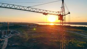 Construction Site At Sunset. 4K. Sunset landscape with a construction site in the middle of it. 4K stock video