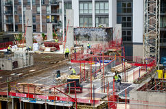 Construction site. Surrounded by modern buildings, in a town setting. Great for construction articles and publications Royalty Free Stock Photo