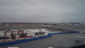 Construction site and taxiing off plane at Moscow Domodedovo airport stock video footage