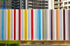 Construction site temporary hoarding fence panel. Colorful construction site temporary hoarding fence panel stock photography
