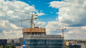 Construction site with three cranes operating timelapse stock footage