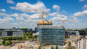 Construction site with three cranes operating timelapse stock video