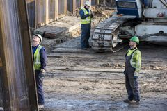 Construction Site Three Workers Driebergen Station. Driebergen, Netherlands - November 26, 2017: Construction site at the railway station in Driebergen, province Stock Photography
