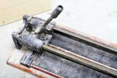 Construction site tool for cutting tiles renovation at home Stock Images