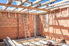 Construction site tools and details - metal ladder, brick layers, wood, timber Stock Photos