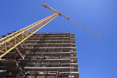 Construction site with tower crane. And blue sky Stock Photos