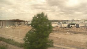 Construction site in train window. Building industry expands town stock video