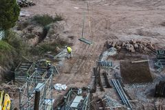 Construction site with workers in Cardona, Catalonia, Spain stock images