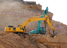 A construction site under preparation. Earthmovers working on a construction site Stock Photos