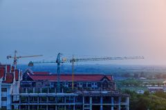 Construction site Unfinished cement building, Industrial construction cranes and building country local Thailand stock photography
