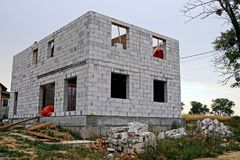 Construction site with unfinished house of white brick Royalty Free Stock Photos