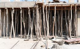 Construction site, using bamboos to support concrete roofing Stock Image