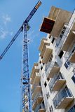 Construction site, view from below of the building and the crane royalty free stock photos