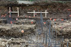 Construction site view of steel rebar foundation framework with orange caps. Horizontal aspect stock photos