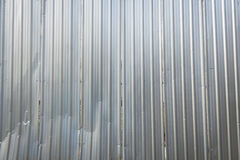 Construction site wall. Background of aluminum corrugated fence at exterior of construction site royalty free stock image