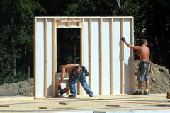 Construction Site - Wall Going Up. The wall of a modular home being put in place Stock Images