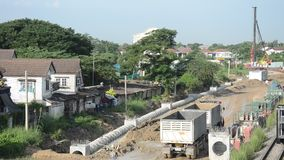Construction site of water drainage concrete pipe near Railway Train stock video