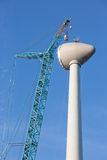 Construction site wind turbine with hoisting of rotor house Stock Photography