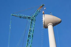 Construction site wind turbine with hoisting of rotor house Royalty Free Stock Photos