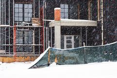 Construction site in winter. Snowfall. On the street stock photography