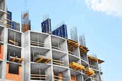 Construction site work. Building construction site work against blue sky Royalty Free Stock Photos