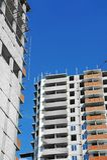 Construction site work. Building construction site work against blue sky Stock Photo