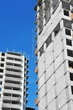 Construction site work. Building construction site work against blue sky Royalty Free Stock Photo