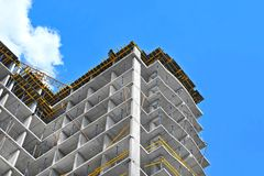 Construction site work. Building construction site work against blue sky Royalty Free Stock Photography