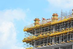 Construction site work. Building construction site work against blue sky Royalty Free Stock Image