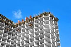 Construction site work. Building construction site work against blue sky Stock Photos