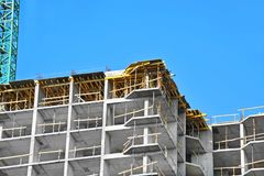 Construction site work. Building construction site work against blue sky Stock Photography
