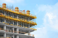 Construction site work. Building construction site work against blue sky Stock Images