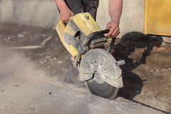 Construction site, worker cut asphalt with saw blade toll Stock Image